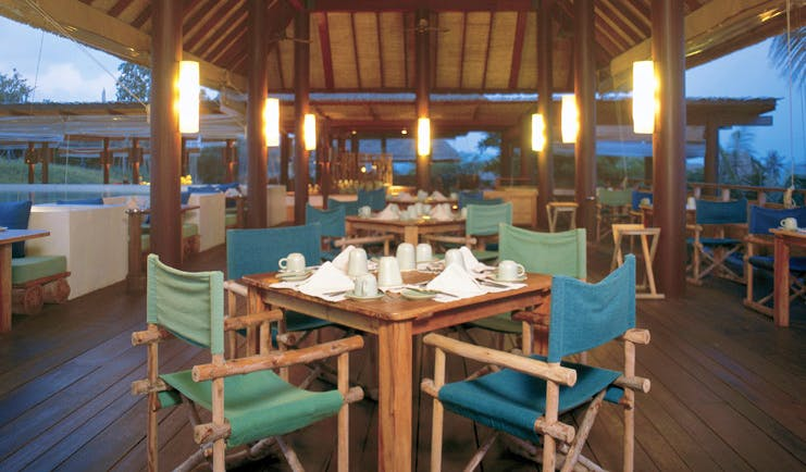Six Senses Samui Thailand Dining on the Hill covered outdoor dining room night time