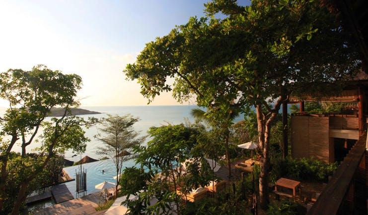Six Senses Samui Thailand outdoor pool aerial view trees ocean view