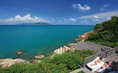 Six Senses Samui Thailand pool suite view couple on deck ocean and island view