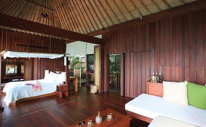 Six Senses Samui Thailand pool suite white sofa wooden walls