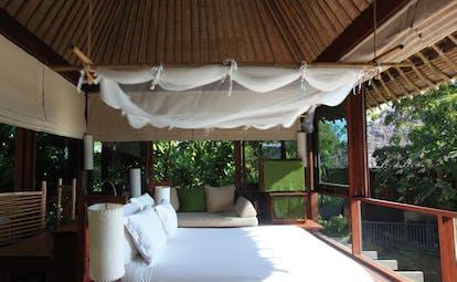 Six Senses Samui Thailand pool villa bedroom sleeping pavilion mosquito drapes garden view sofa