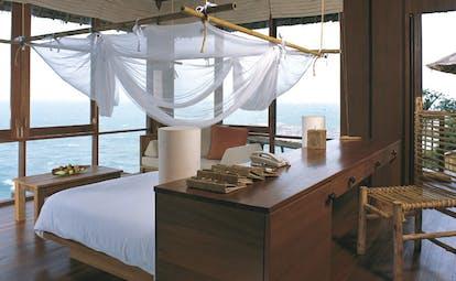 Six Senses Samui Thailand pool villa bedroom white mosquito drapes panoramic ocean view