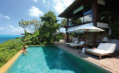 Six Senses Samui Thailand presidential villa pool sun loungers ocean view gardens