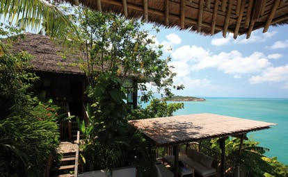 Six Senses Samui Thailand presidential villa view thatched rooves ocean view