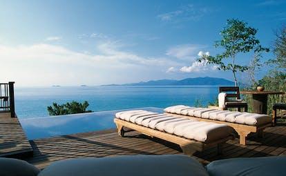 Six Senses Samui Thailand private infinity pool deck sun loungers ocean view