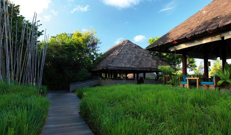 Six Senses Samui Thailand restaurant entrance path through gardens to dining pavilion