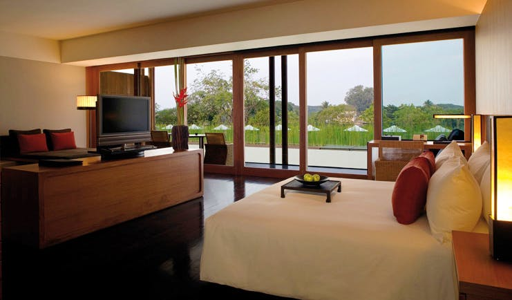 The Dhara Devi Thailand club suite bedroom sitting area panoramic window river view