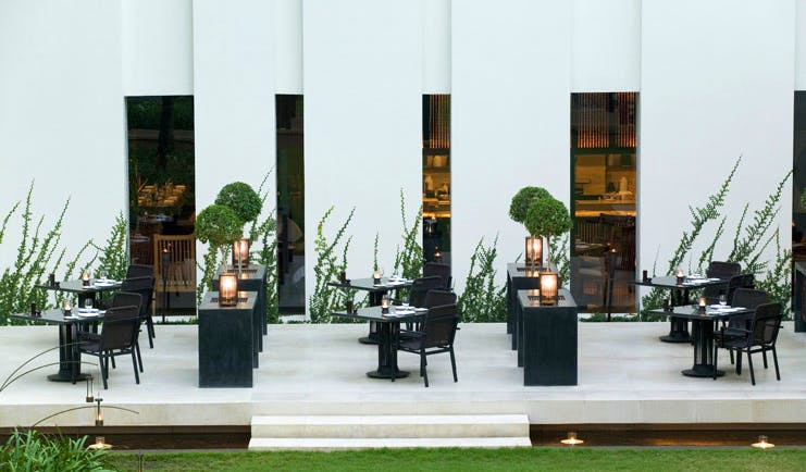 The Dhara Devi Thailand courtyard dining modern white building lawns