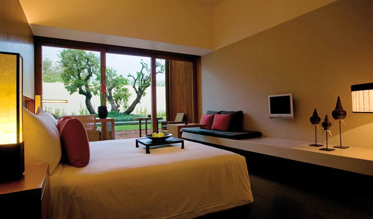The Dhara Devi Thailand deluxe bedroom sitting area river and tree view