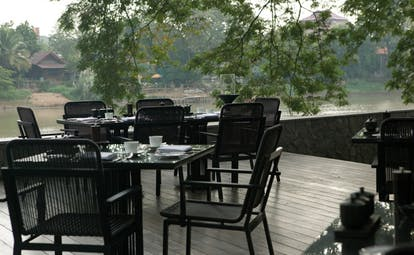 The Dhara Devi Thailand restaurant terrace deck outdoor dining area river view