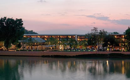 The Dhara Devi Thailand river view of the hotel at sunset
