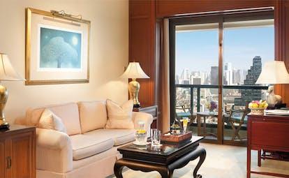 The Peninsula Bangkok Thailand balcony room lounge classic decor with city view