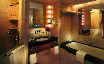 The Peninsula Bangkok Thailand grand deluxe suite bathroom marble decor shower and bath