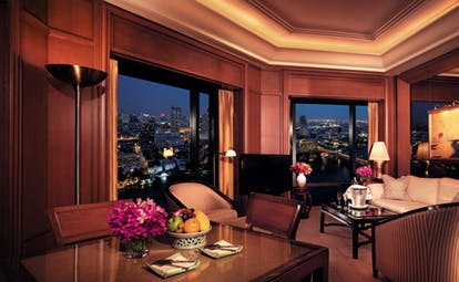 The Peninsula Bangkok Thailand grand deluxe suite lounge sitting area sofas desk river and city views