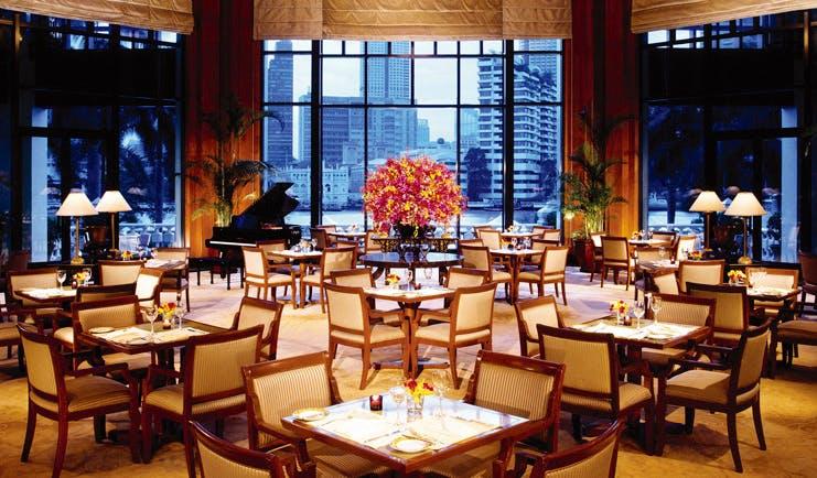 The Peninsula Bangkok Thailand indoor dining room panoramic riverside views