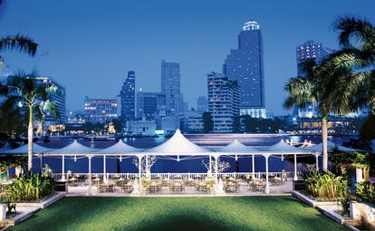 The Peninsula Bangkok Thailand lawns outdoor terrace dining aerial river and city views