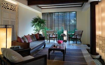 The Peninsula Bangkok Thailand lounge area with sofas and white columns