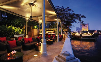 The Peninsula Bangkok Thailand River bar outdoor lounge area with sofas and river views