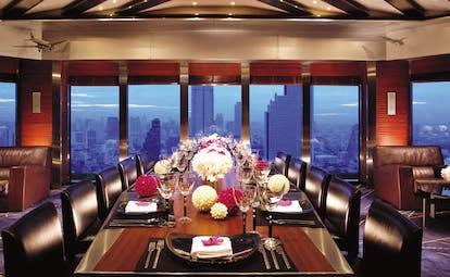 The Peninsula Bangkok Thailand river view restaurant dining room with panoramic river views
