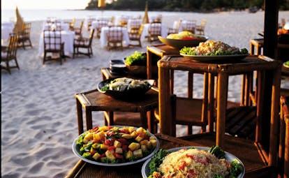 The Surin Phuket Thailand beach cuisine salad dishes dining area