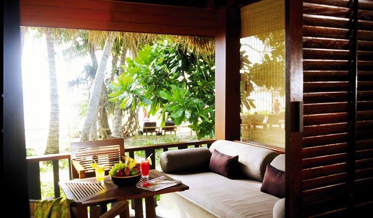 The Surin Phuket Thailand beach deluxe terrace sofa garden palm trees