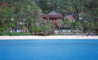 The Surin Phuket Thailand beach ocean palm trees hotel buildings