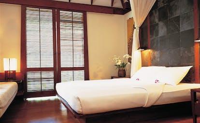 The Surin Phuket Thailand bedroom grey slate walls minimalist decor