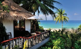 The Surin Phuket Thailand cottage sea view balcony palm trees