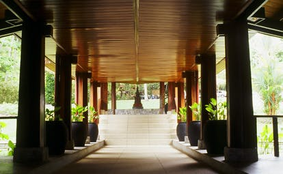The Surin Phuket Thailand covered walkway trees greenery statue