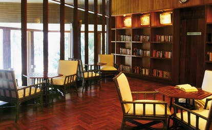The Surin Phuket Thailand library bookshelves large windows seating areas