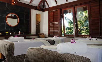 The Surin Phuket Thailand spa room two treatment beds modern decor