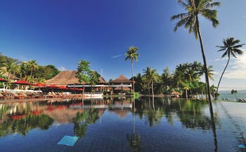 Vijitt Resort Thailand pool infinity pool sun loungers umbrellas overlooking beach