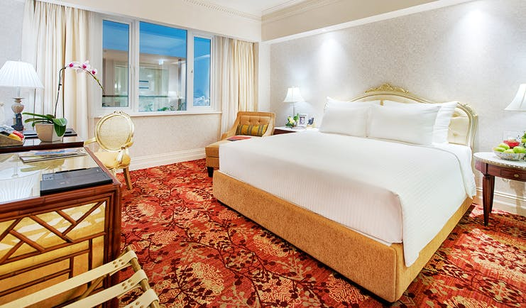 Apricot Hotel deluxe sketch room, double bed, desk, elegant decor
