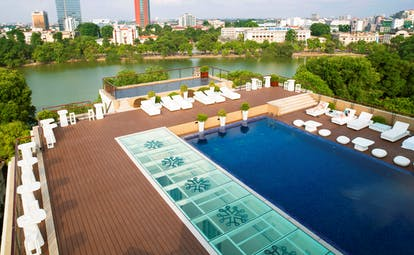 Apricot Hotel rooftop pool, sun loungers, view over river and city