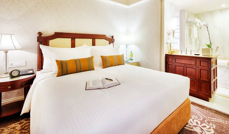 Apricot Hotel studio bedroom, king size bed, elegant decor, en suite shower room