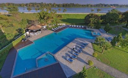 Azerai La Residence pool, sun loungers, gardens, trees