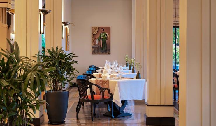Azerai La Residence la parfum restarant, tables and chairs, elegant decor, plants, columns