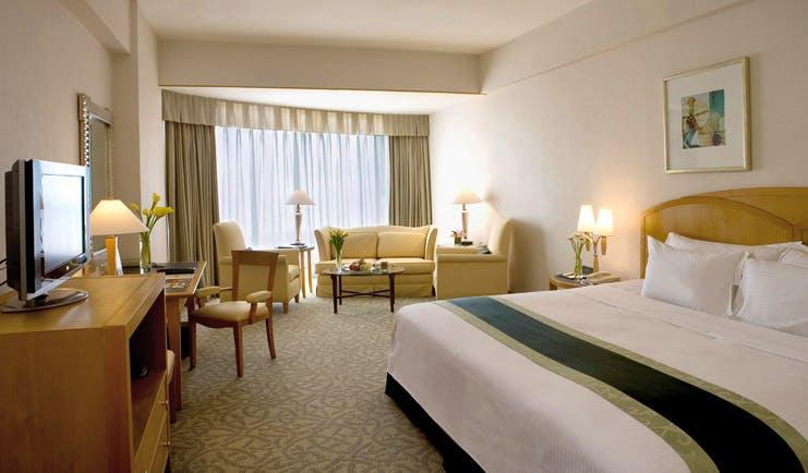 Caravelle Hotel Vietnam premium deluxe bedroom with lounge area