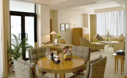 Caravelle Hotel Vietnam presidential suite lounge writing desk sofa armchair and dining area
