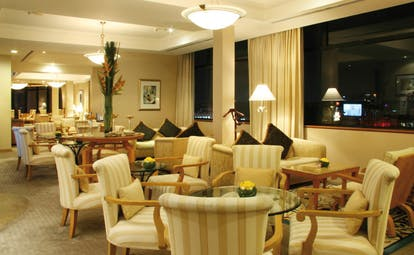 Caravelle Hotel Vietnam signature lounge seating area armchairs tables and sofas city view