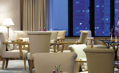 Caravelle Hotel Vietnam signature lounge seating area with city views