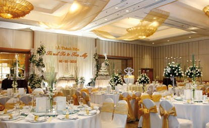 Caravelle Hotel Vietnam wedding reception room covered chairs floral arrangements
