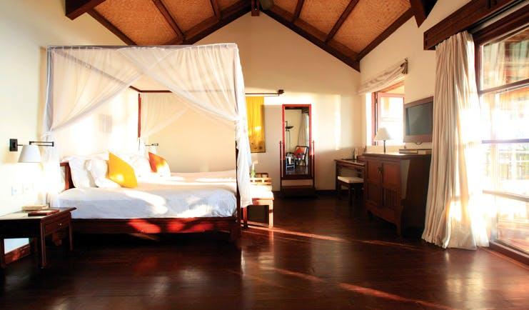 Evason Ana Mandara Resort Vietnam Ana Mandara suite large four poster bed with mosquito drapes
