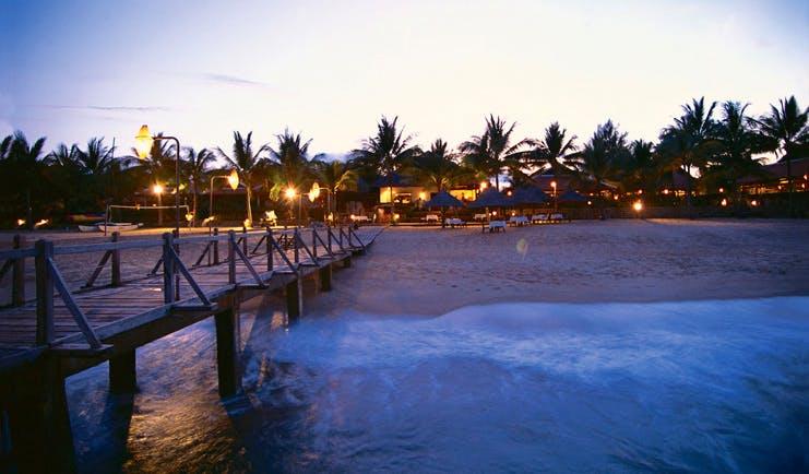 Evason Ana Mandara Resort Vietnam beach from jetty hotel view palm trees twilight