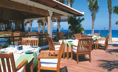 Evason Ana Mandara Resort Vietnam beach restaurant outdoor dining area deck palm trees ocean view