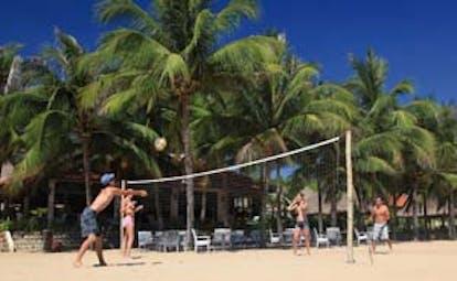 Evason Ana Mandara Resort Vietnam beach volleyball palm trees beach seating area