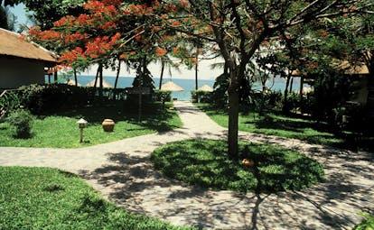 Evason Ana Mandara Resort Vietnam garden path to the beach and loungers
