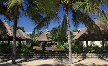 Evason Ana Mandara Resort Vietnam outdoor spa wooden thatched huts palm trees