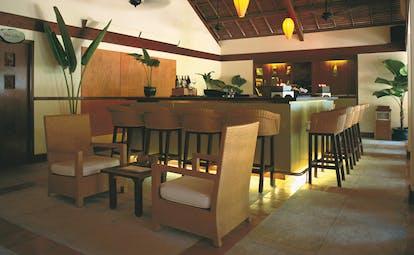 Evason Ana Mandara Resort Vietnam veranda bar indoor bar with stools and chairs modern decor