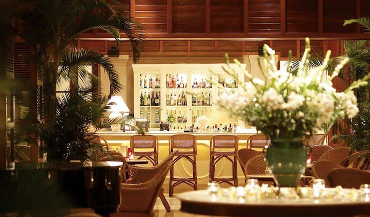 Furama Resort Vietnam bar indoor seating area authentic décor fresh flowers